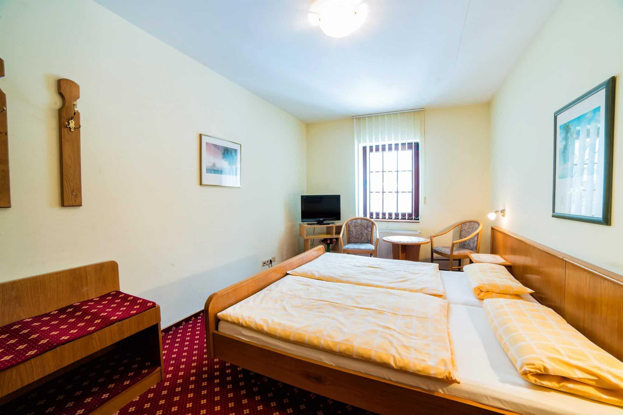 Hotel Pension Hafemann - Zimmer mit Doppelbett